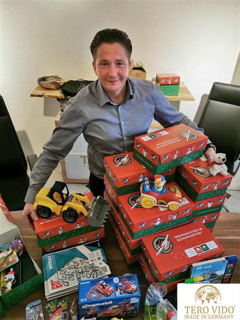 CEO Tero Vido with gifts